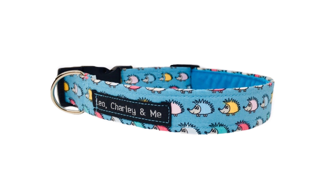 Washable fabric dog collar in turquoise with a cute multicoloured hedgehog print.