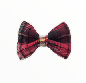 Handmade dog bow tie in cotton print. Made by hand in the U.K. and washable. Red tartan cotton and wool mix dog bow tie. Perfect for Christmas.