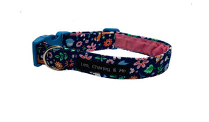 Pretty blue cotton poplin dog collar with flowers, leaves and woodland creatures printed on it. It has a soft baby pink velvet lining and a pale blue curved side release buckle. Hand made in the U.K. and washable.