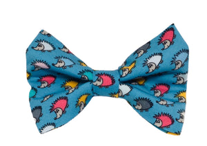 Dog bow tie in turquoise cotton hedgehog print fabric. Covered in multicoloured tiny hedgehogs. Handmade in the U.K.