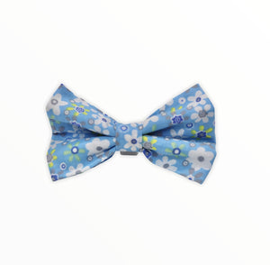 Handmade dog bow tie in cotton print. Made by hand in the U.K. and washable. Blue floral  dog bow tie.