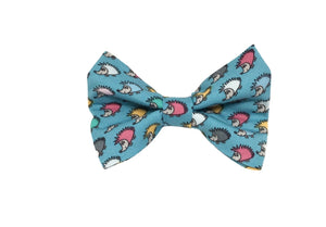 Handmade dog bow tie in cotton print. Made by hand in the U.K. and washable. Turquoise cotton with hedgehog print.