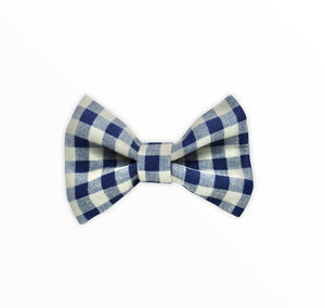 Handmade dog bow tie in cotton print. Made by hand in the U.K. and washable. Navy and cream checked cotton bow.