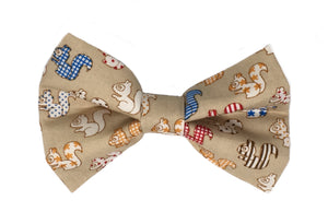 Handmade dog bow tie in cotton print. Made by hand in the U.K. and washable. Sandy coloured cotton poplin printed with squirrels.
