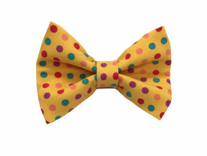 Handmade dog bow tie in cotton print. Made by hand in the U.K. and washable. Sunshine yellow cotton poplin with multicoloured spots.