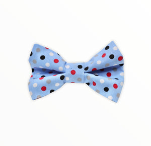 Handmade dog bow tie in cotton print. Made by hand in the U.K. and washable. Pale blue with polka dots in red blue and white
