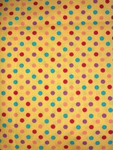 Cotton fabric face mask in a dotted yellow print. Handmade in the UK & washable.