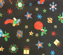 Christmas cotton poplin dog bandana in navy with festive stockings, snowflakes,stars and baubles. Handmade in the U.K. and washable