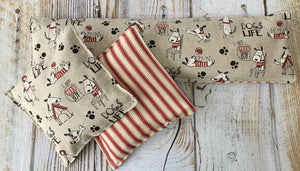 Handmade cherry stone pillow and wrap in a Dogs' Life cotton canvas print. Washable and made in the U.K.