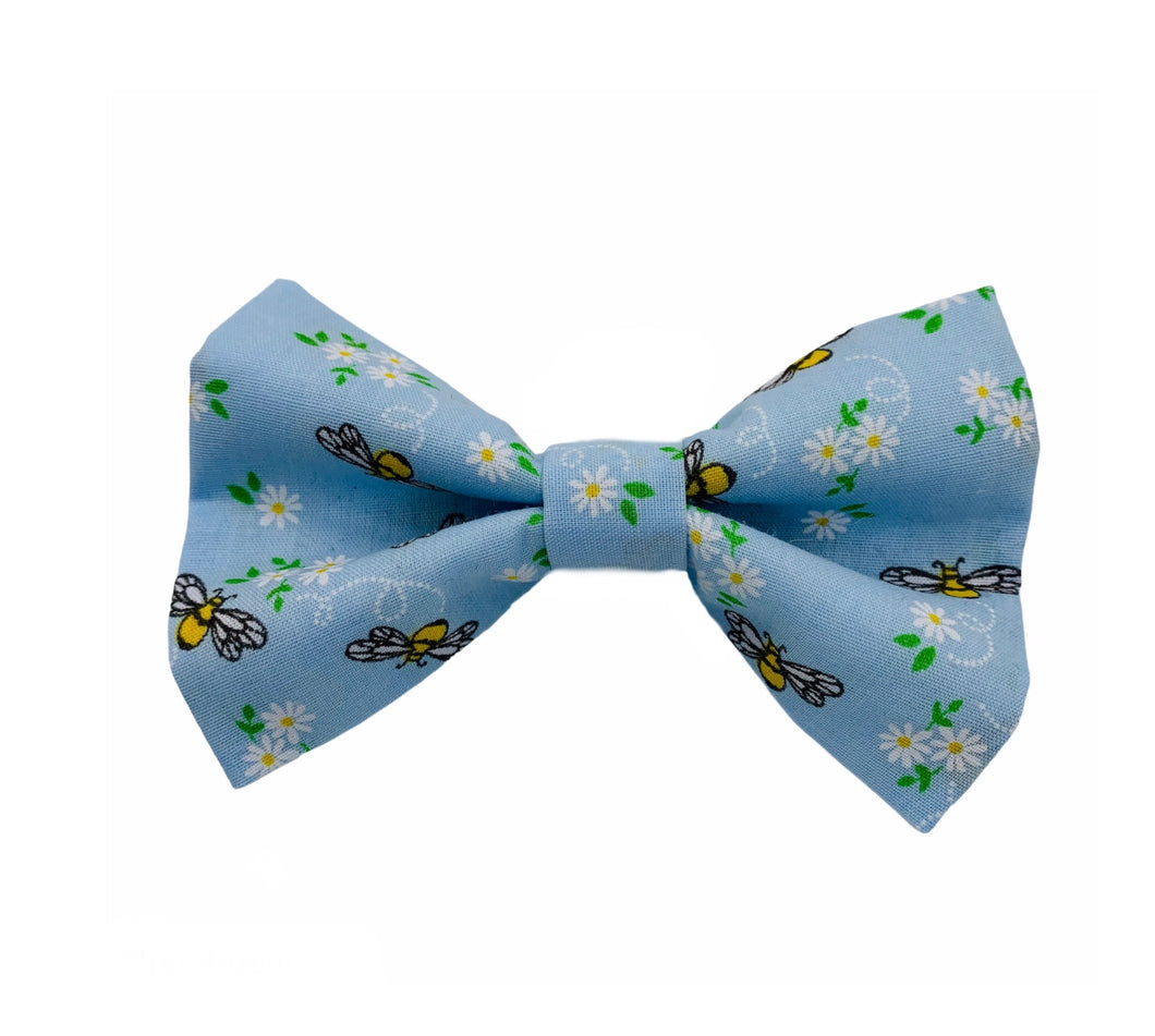 Handmade dog bow tie in cute cotton bee print. Washable and made in the UK. Matching items available