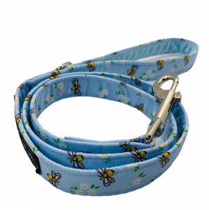 Hand madedog lead in blue cotton bee and floral print. Zinc alloy trigger hook and velvet lined handle. Hand made in the UK and washable.