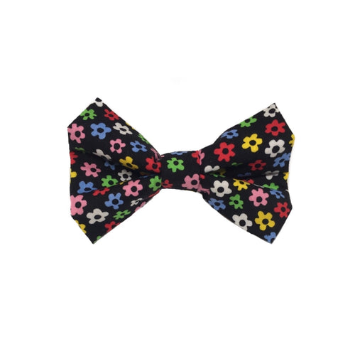Black cotton fabric dog bow tie printed with multicoloured flowers.  Washable and handmade in the U.K.