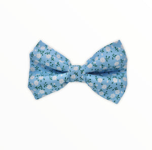 Handmade dog bow tie in cotton print. Made by hand in the U.K. and washable. Blue cotton poplin dog bow tie with teeny tiny white floral print