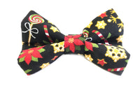 Washable cotton Christmas dog bow tie in a vibrant print of flowers candy canes and lollipops. Handmade in the U.K. and washable.
