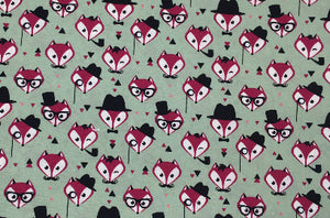 Foxy Gentleman sage green fabric dog lead printed with foxy faces. Handmade and washable.