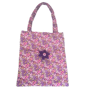 Padded cotton tote in lilac meadow print. Handmade in the U.K., washable. Internal and external pockets.