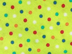 Apple green fabric dog collar with multicoloured polka dot print. Hand made in the U.K. and washable.