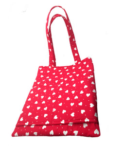 Red cotton padded toe bag dotted with tiny white hearts. Big enough to carry your dog walking essentials plus a phone, purse and water bottle so you can twin with your dog. Handmade in the U.K. and washable.