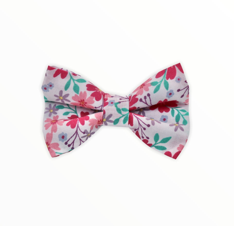 Handmade dog bow tie in a pretty pink floral fabric. Made in the UK and washable.