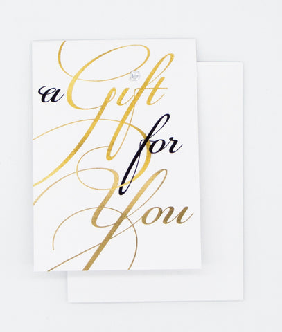 black and gold script writing saying a gift for you