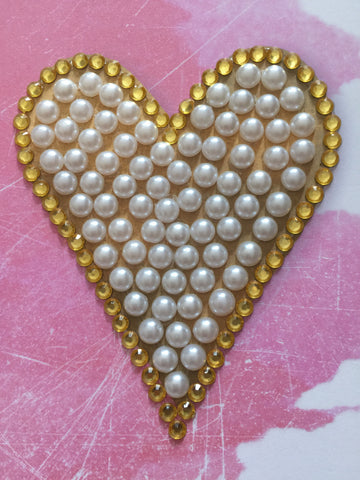 Pearls and jewel heart with pink background greeting card
