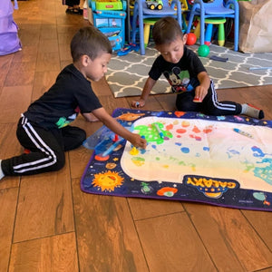 Twins share the water doodle mat toy! What a sweetie!