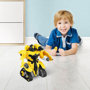 the boy are on the floor, the yellow rc robot toy is cute