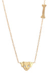 14k yellow gold dog and bone gold necklace from jewelry designer Victoria Cunningham alchemy jeweler