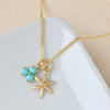 Anne Sportun Star Charm on chain with turquoise trillium charm