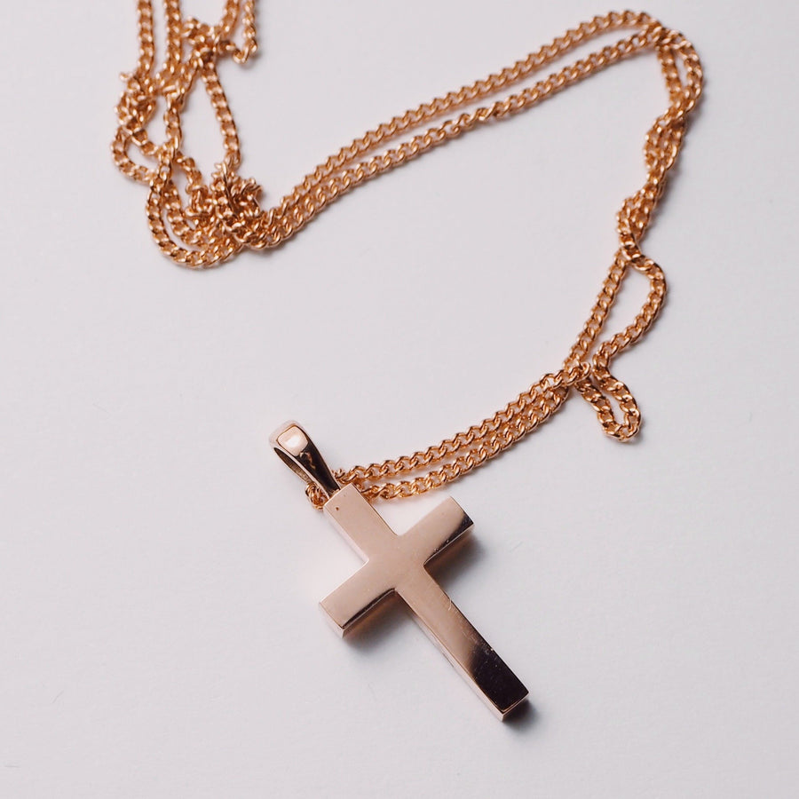 A Gold Cross Pendant