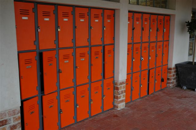 3 tier plastic lockers in orange at a primary school