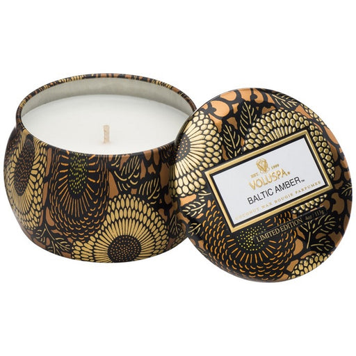 A coconut wax candle in a decorative japanese inspired tin baltic amber