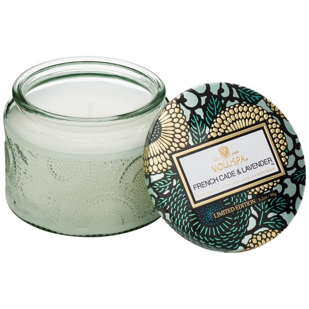 A coconut wax candle in a decorative glass jar lavender