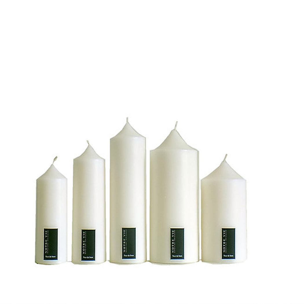 Elegant white bell top pillar candles made in new zealand