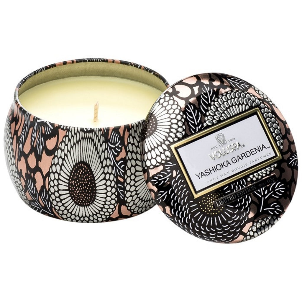 A coconut wax candle in a decorative japanese inspired tin