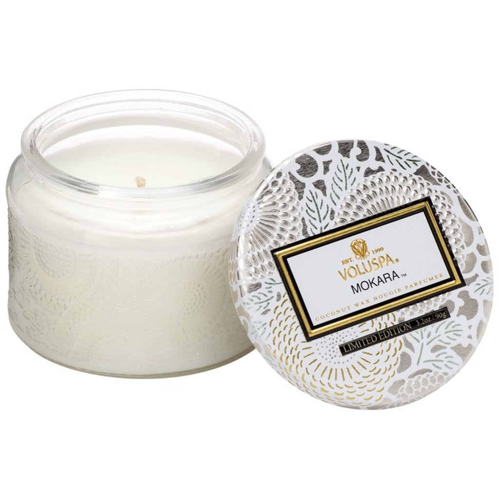 A coconut wax candle in a decorative glass jar mokara fragrance