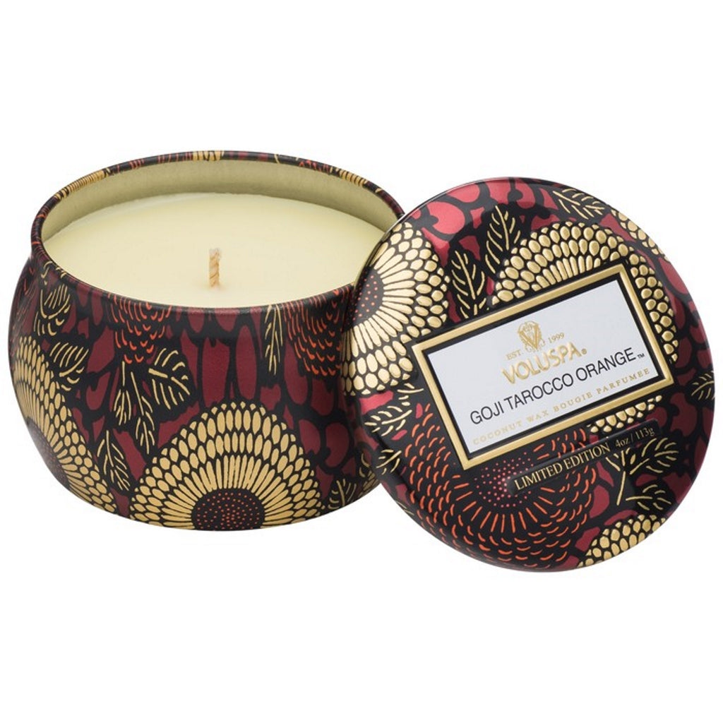 A coconut wax candle in a decorative japanese inspired tin orange goji