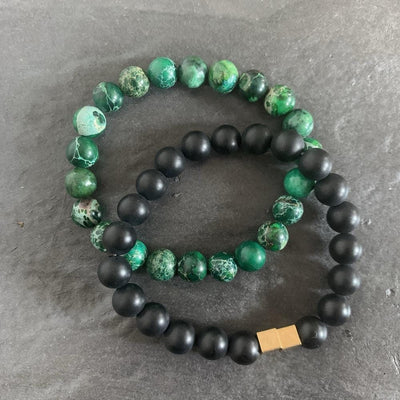 Green regalite bracelet and black onyx bracelet