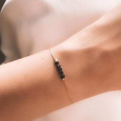 Gold bracelet black spinel
