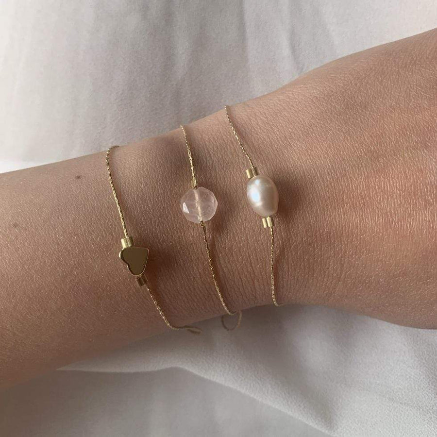Rose quartz bracelet on gold chain