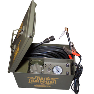 green ammo can with compressor, power cable, pressure gauge and accessory box
