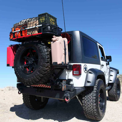 white tricked out jeep with spare tire rack gas & water cans supplies and M240 air compressor
