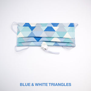 Blue and white designer mask with triangle pattern.