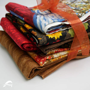 Farm Quilt Kit Closeup Fabrics with Brown Red Orange Yellow