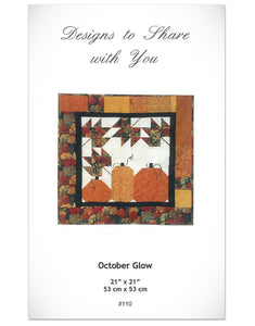 October Glow quilt pattern with pumpkin and leaf designs at Anderson Fabrics
