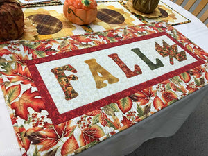 Fall lettering and leaves of orange, red and yellow
