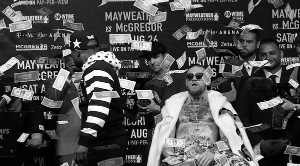 Mayweather throwing money on McGregor