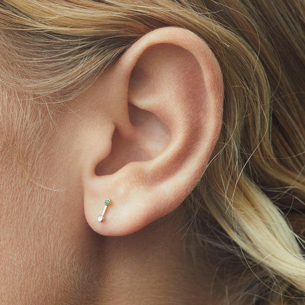 dog with a bone labret green yellow gold on ear