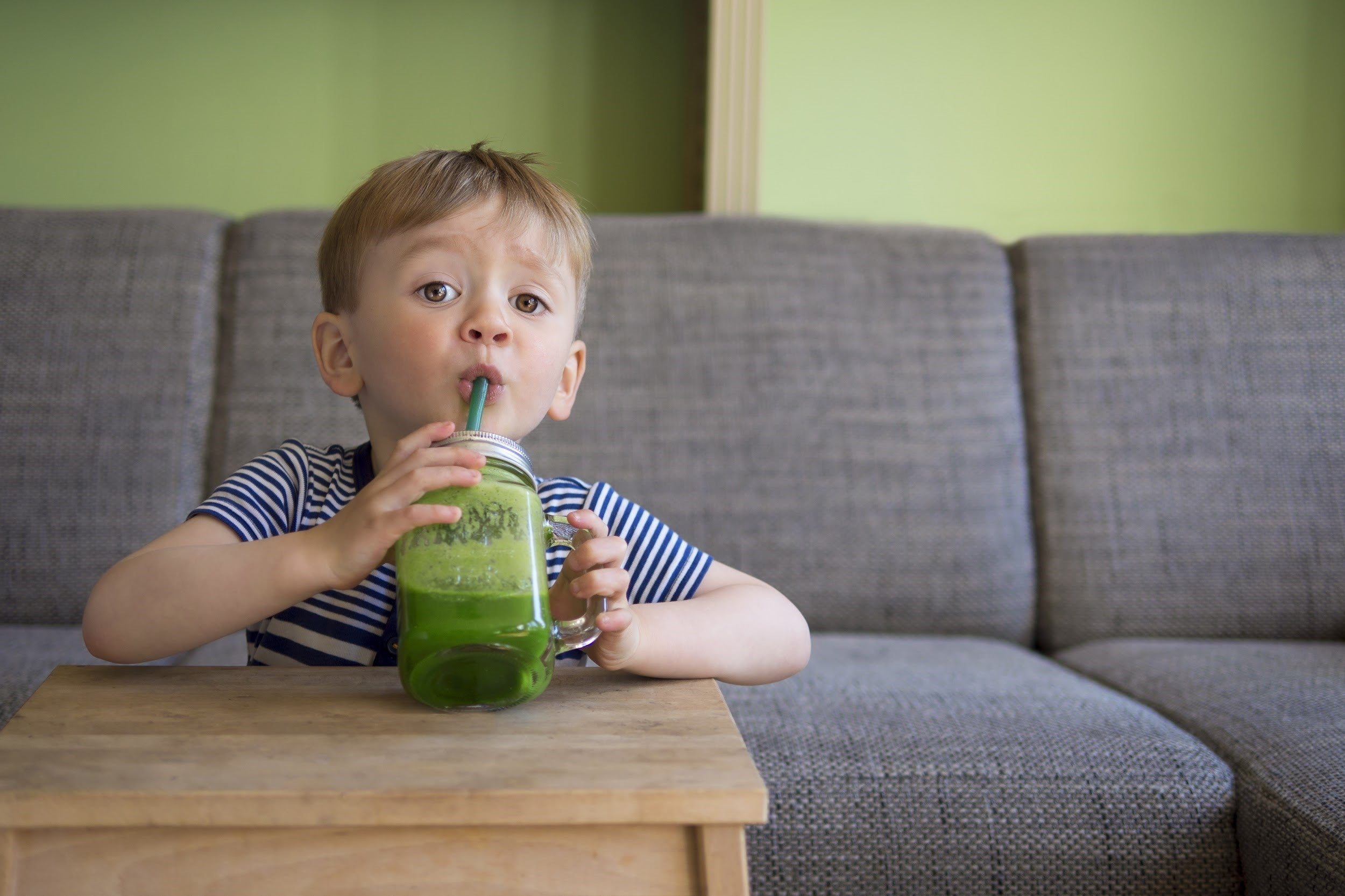 best foods for sick kids by illness - spinach/banana smoothie and leafy greens for aches and pain