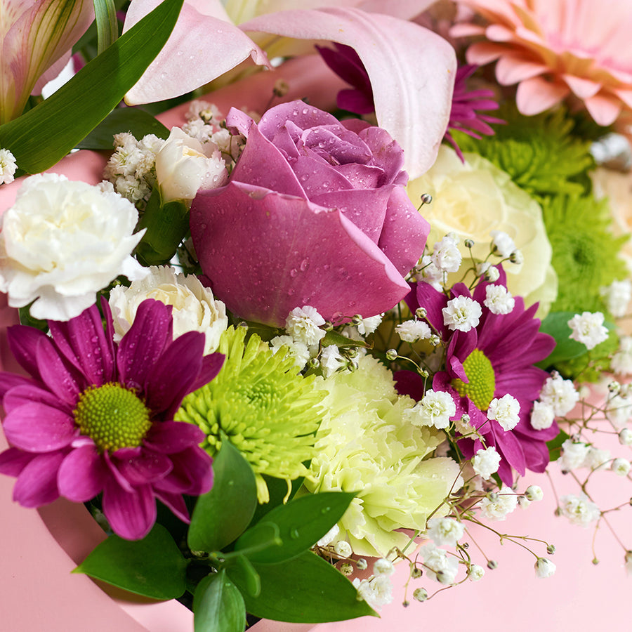 Pink and white mixed floral arrangement in a pink toolbox. Same Day Toronto Delivery.